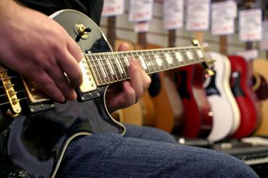 buying a guitar. Black Bedroom Furniture Sets. Home Design Ideas